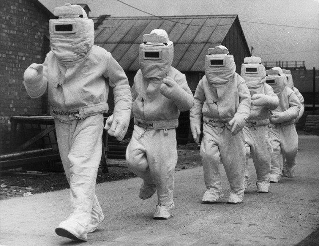 A demonstration of asbestos fire fighting suits - Source: William Vanderson/Fox Photos/Getty Images