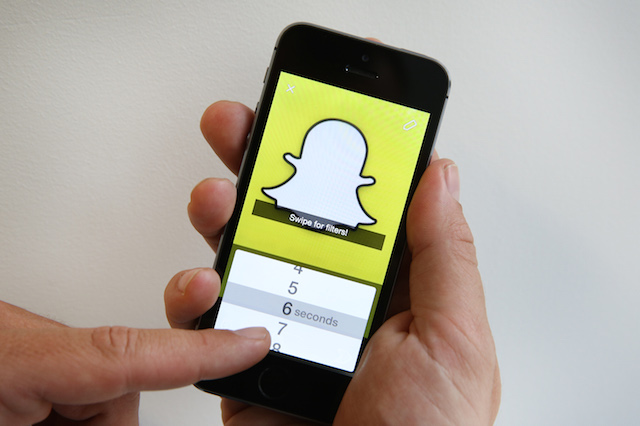In this photo illustration the Snapchat app is used on an iPhone on October 6, 2014 in London, England. Snapchat allows users' messages to vanish after seconds.
