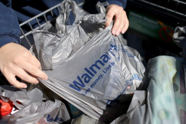 A customer prepares to load her car with the purchases she made at a Walmart store - Source: Joe Raedle/Getty Images