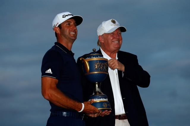 Dustin Johnson of the United States and Donald Trump pose with the Gene Sarazen Cup - Source: Sam Greenwood/Getty Images