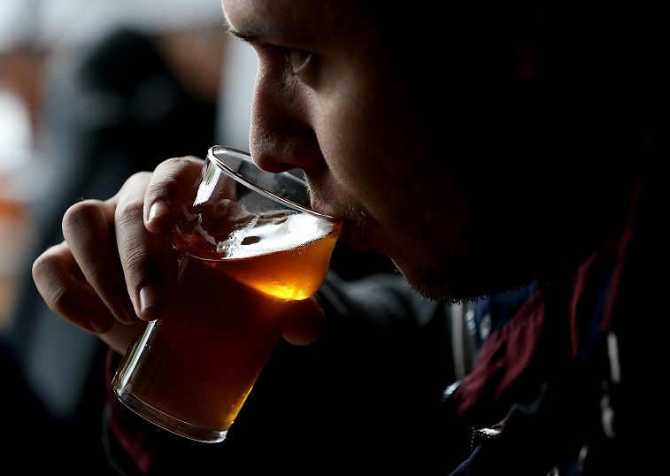 A Russian River Brewing Company customer takes a sip -