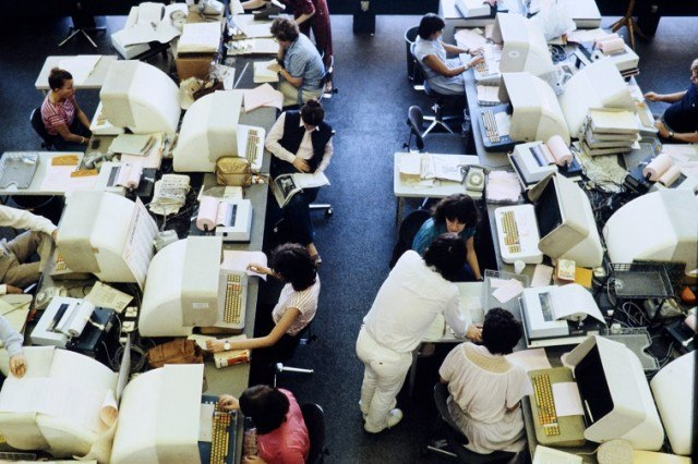 Journalists are seen working on computers - Source: AFP/Getty Images