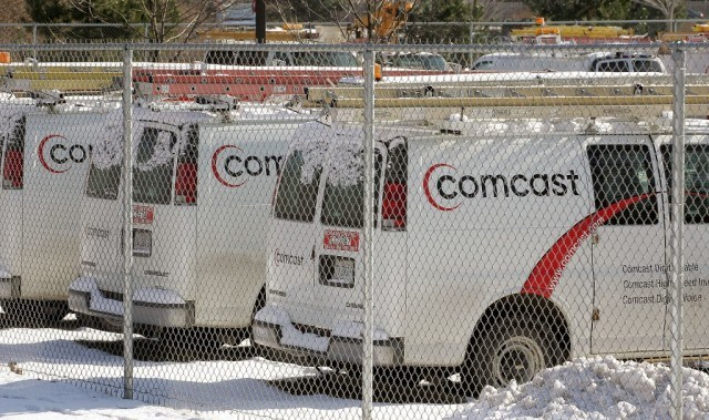 Comcast vans behind a fence