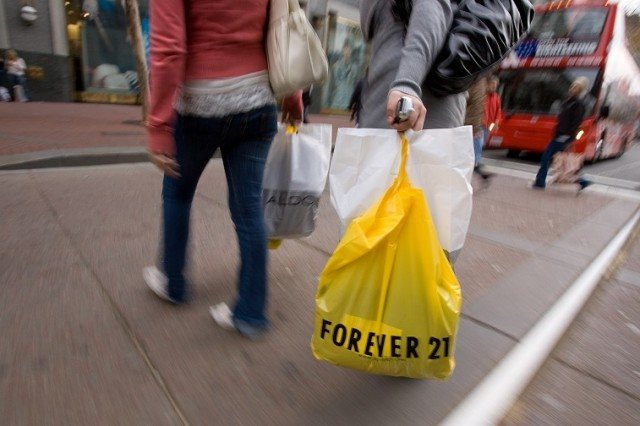 Shoppers walk in downtown San Francisco with a Forever 21 bag - David Paul Morris/Getty Images