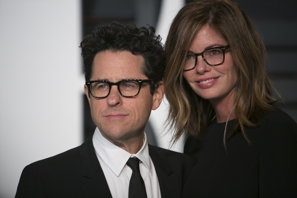 Director J.J. Abrams with his wife, posing on the red carpet