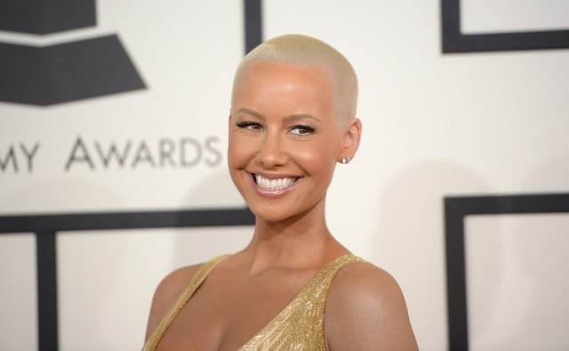 Amber Rose smiles in a yellow gown at the Grammy Awards.
