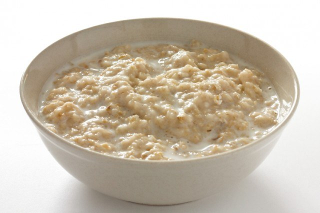 A white bowl of oatmeal.