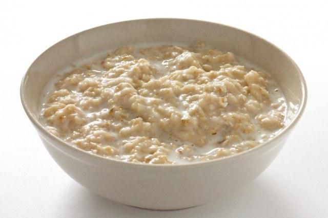 A white bowl of oatmeal.