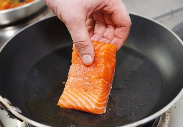 Frying a piece of fish