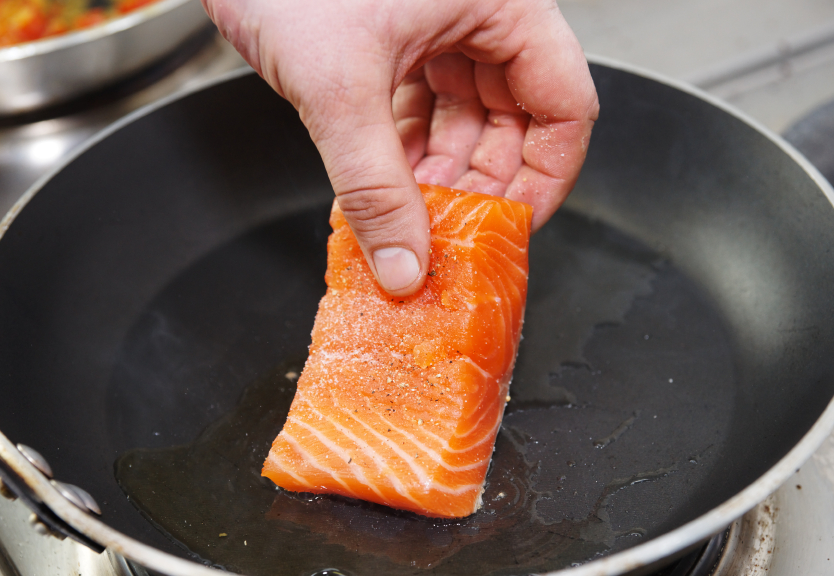 Pan-frying a slab of salmon