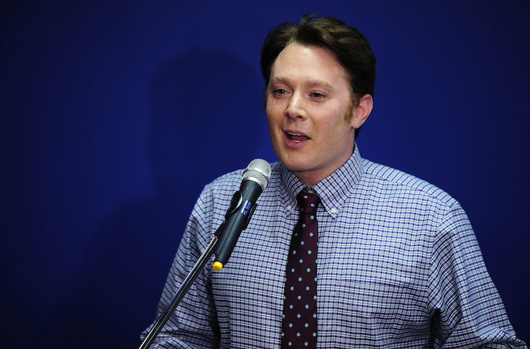 Clay Aiken speaking into a microphone