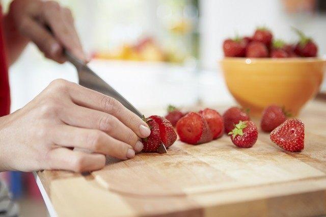 cutting strawberries