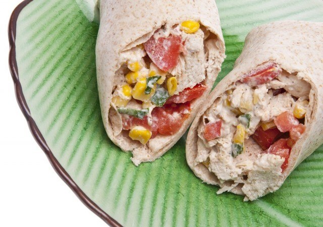 tortillas stuffed with vegetables and sauce
