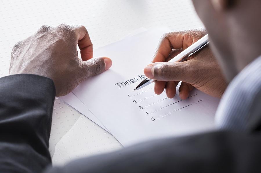 A man writes a to-do list