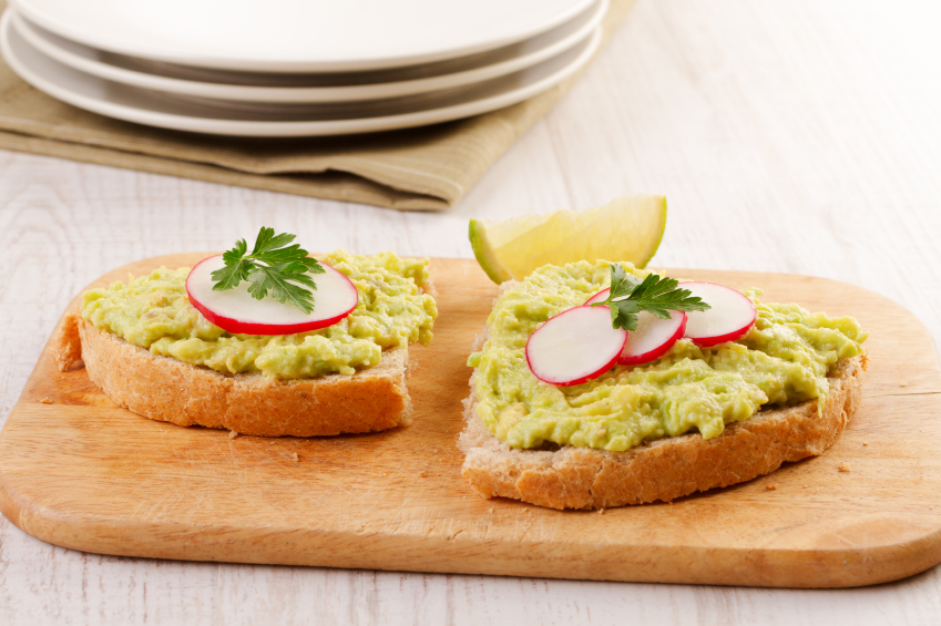 Mashed avocado on toast with veggies.