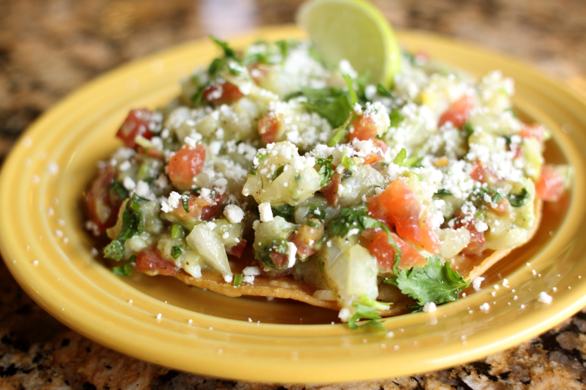 tostada with chicken, veggies, and cheese