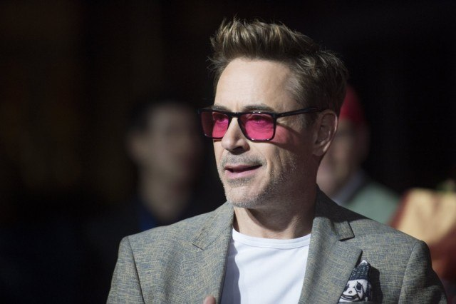 Robert Downey Jr. wearing red shades and a gray suit.