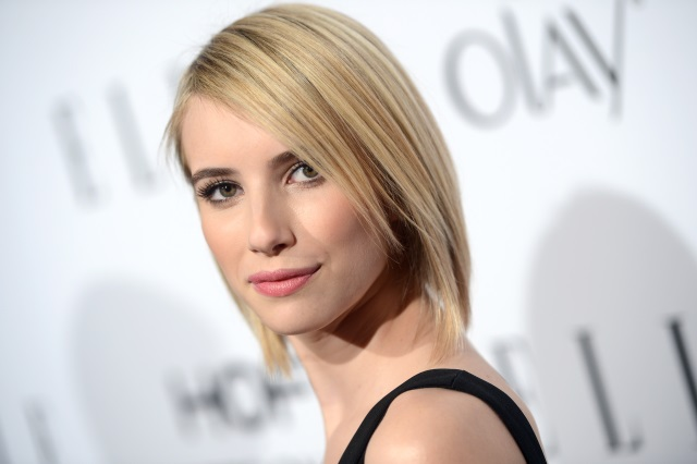 Emma Roberts posing on a red carpet.