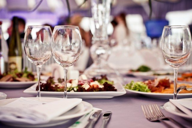 Restaurant table with glasses and salads