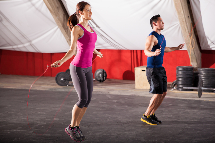 Man and woman jumping rope