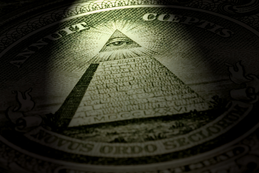 pyramid on dollar bill representing pyramid schemes