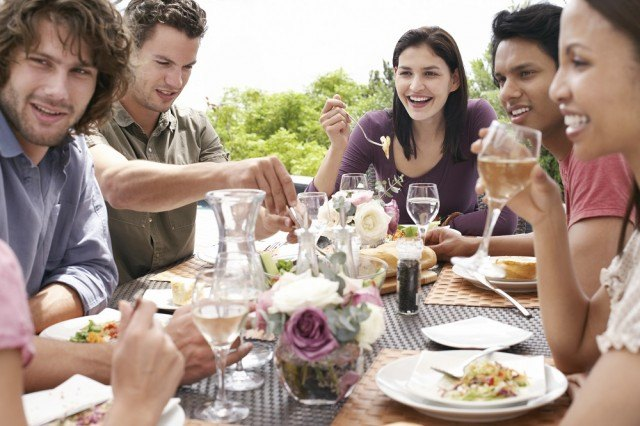 a group of friends eating and talking