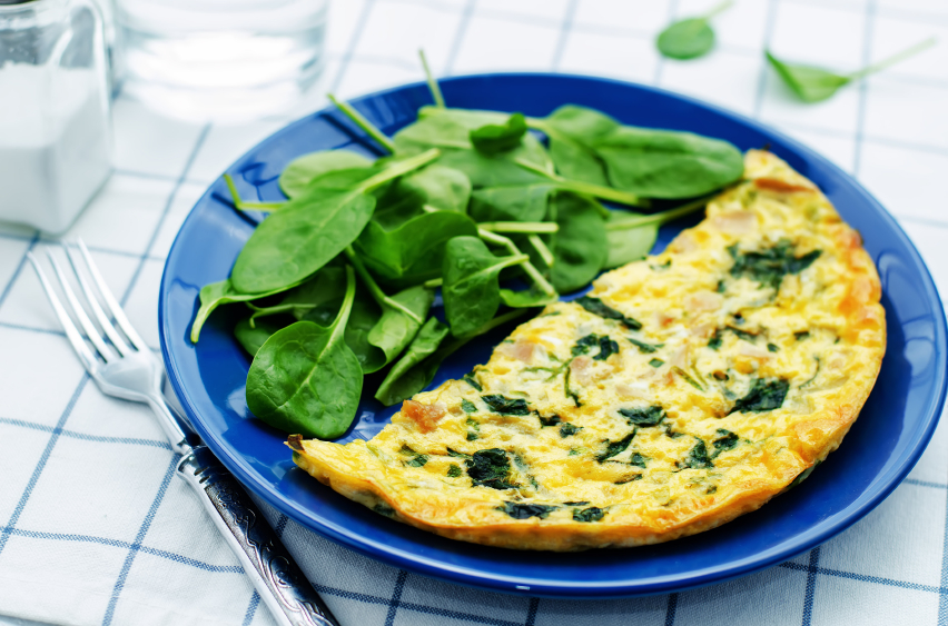 Frittata with spinach on a blue plate