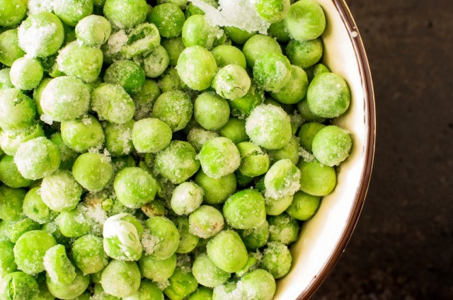 close-up of a bowl of frozen peas