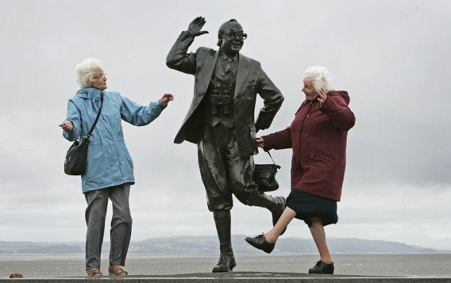 Elderly Brits dance next to a statue of Eric Morcambe - Christopher Furlong/Getty Images