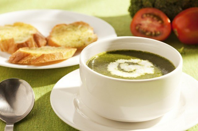 A healthy herbed soup served with croutons
