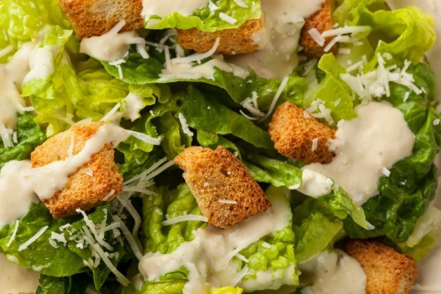Greens with creamy dressing, croutons, and cheese