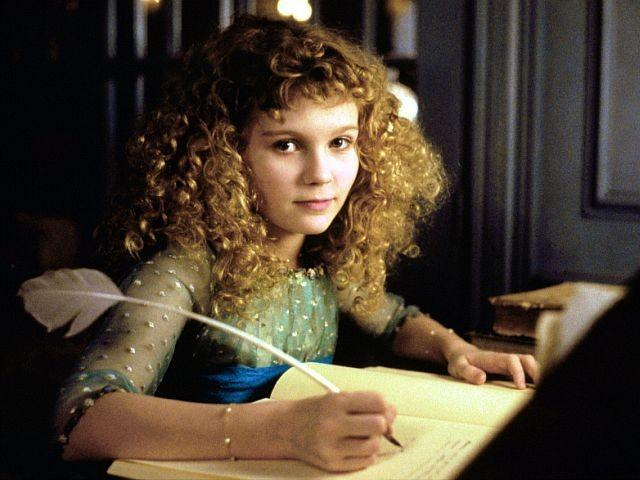 Young Kirsten Dunst tries in a notebook in a scene from Interview with a Vampire