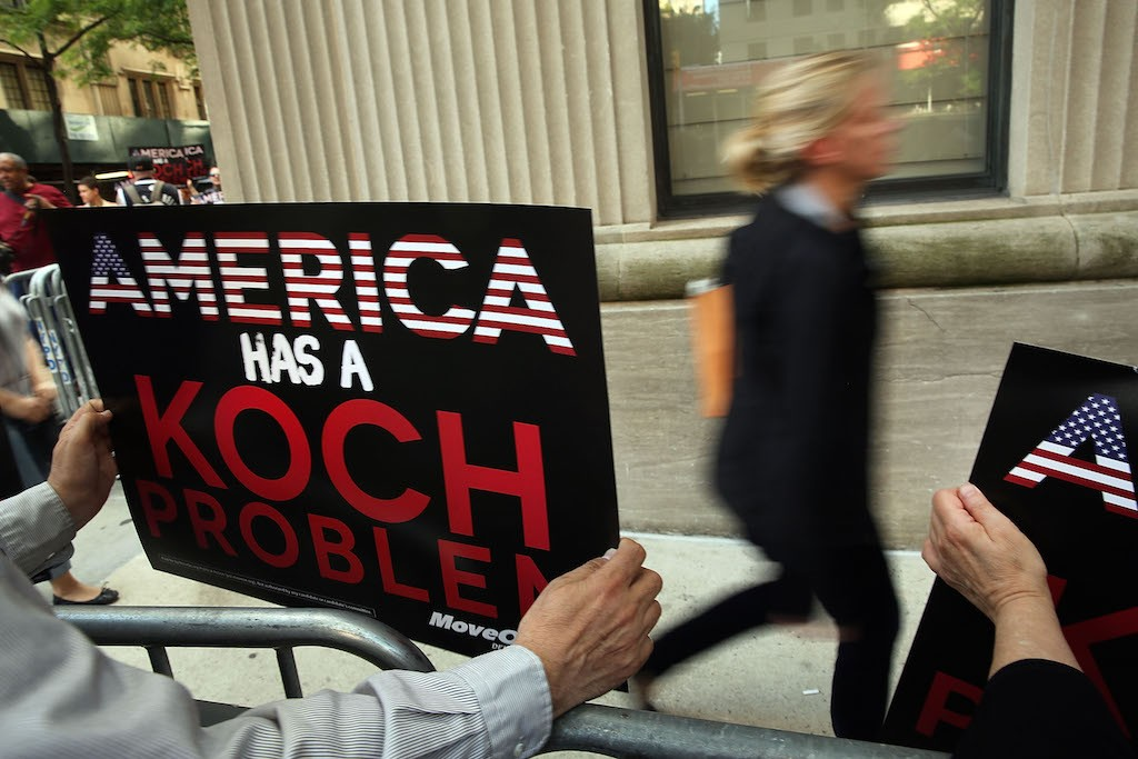 Activists hold a protest near the Manhattan apartment of billionaire and Republican financier David Koch on June 5, 2014 in New York City. The demonstrators were protesting against the campaign contributions by the billionaire Koch brothers who are owners of Koch Industries Inc. The brothers have become a focus of Democrats and liberals as they are accused of skewing the political playing field with their finances. (Photo by Spencer Platt/Getty Images)