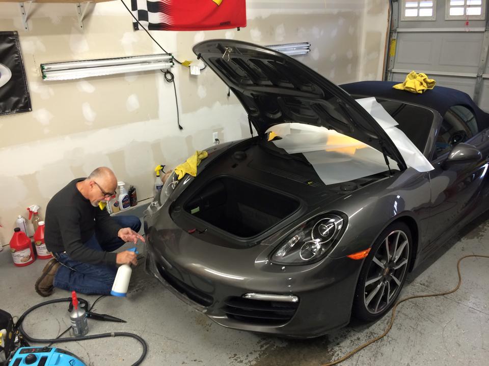 Man taking care of car