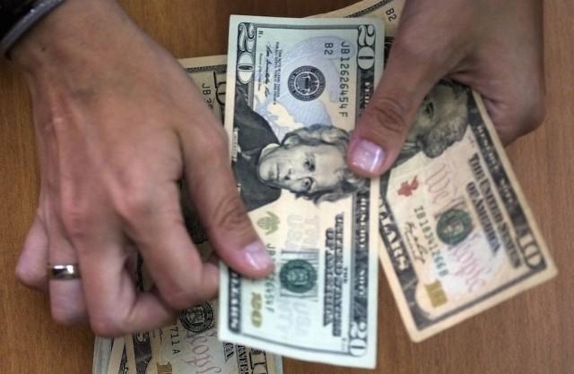 A woman counts out cash
