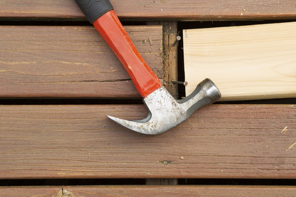 A hammer engaged in home repairs