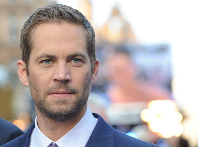Paul Walker looking to his left while on the red carpet