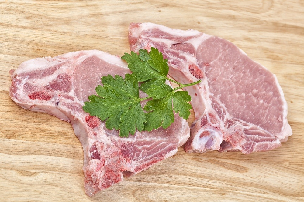 Raw pork chops with parsley