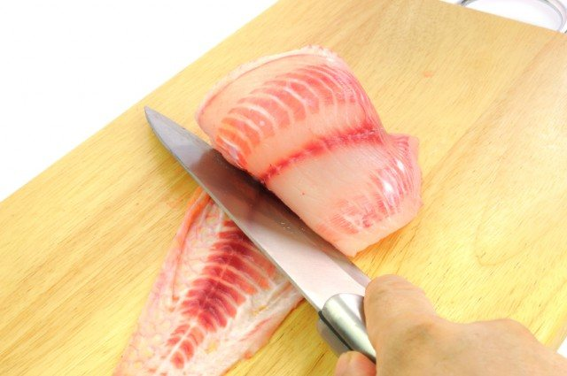 fresh tilapia being cut