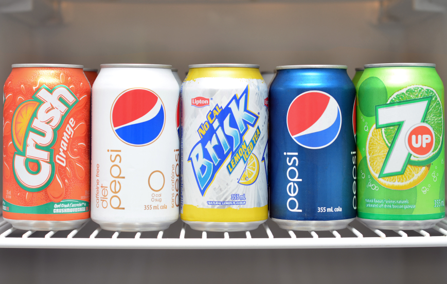 Soda cans seen in a refrigerator