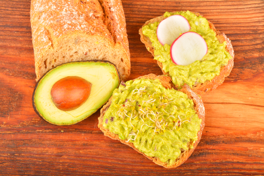 Sandwiches with avocado, radish and germs sprouts