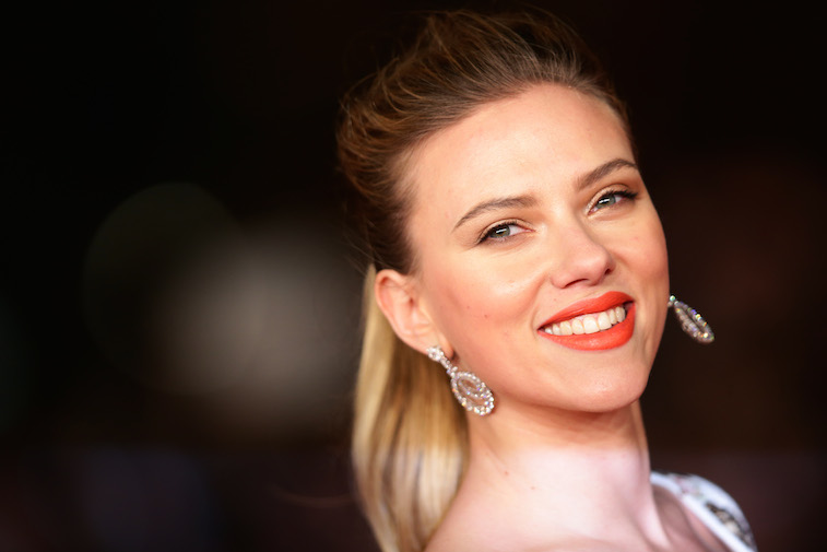 Scarlett Johansson with her hair in a ponytail smiling.
