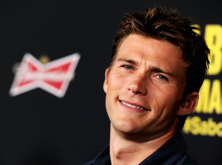 Scott Eastwood smiles for cameras