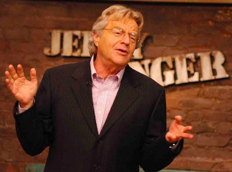 Jerry Springer gestures with his hands while on the set of the Jerry Springer show