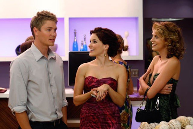 Lucas, Brooke, and Peyton at a party in 'One Tree Hill'.