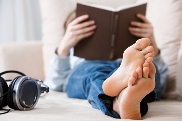Man reading book on bed