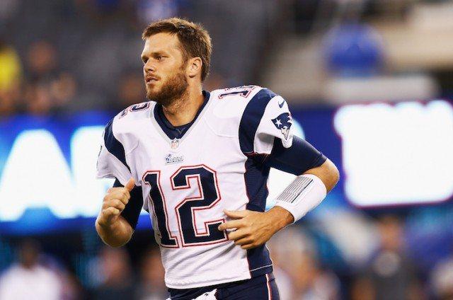 Tom Brady running on football field