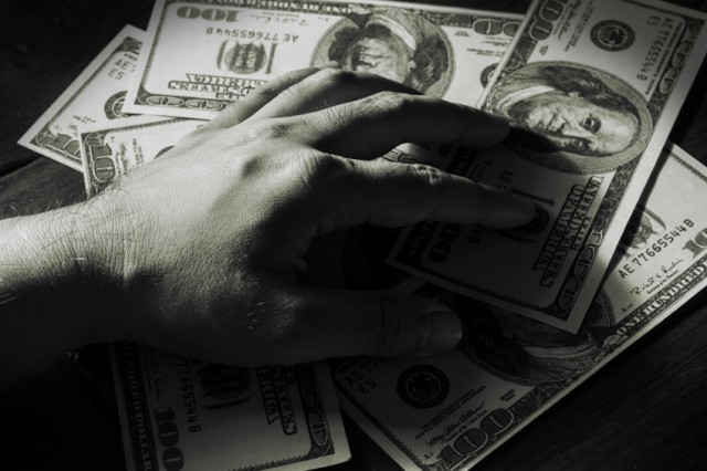 A hand grabbing money