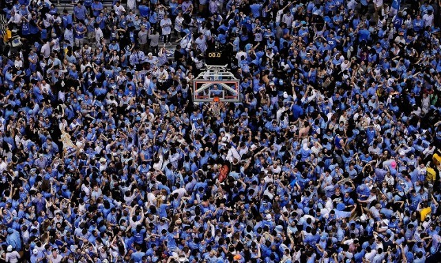 a huge crowd at a basketball game