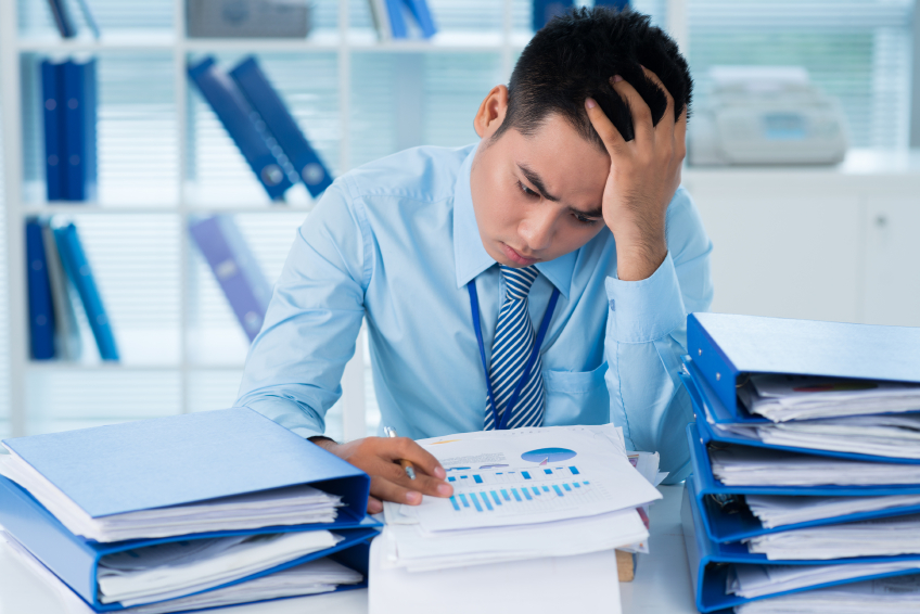 A man sifts through piles of papers